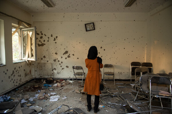 A student looking at the ruins of a classroom at Kabul University, after an attack that killed 22 students in 2020.