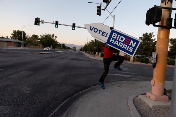 Brandon Urlacher, a hired sign spinner, on the job in Las Vegas near Rancho High School on Election Day.