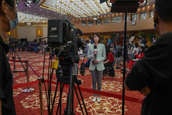 A reporter for China Central Television, the government-controlled broadcaster, in May in Beijing.