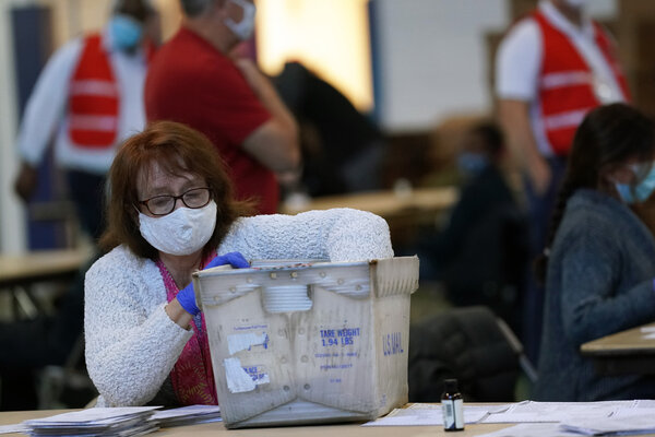 An election worker counts ballots in West Chester, Pennsylvania on Wednesday.