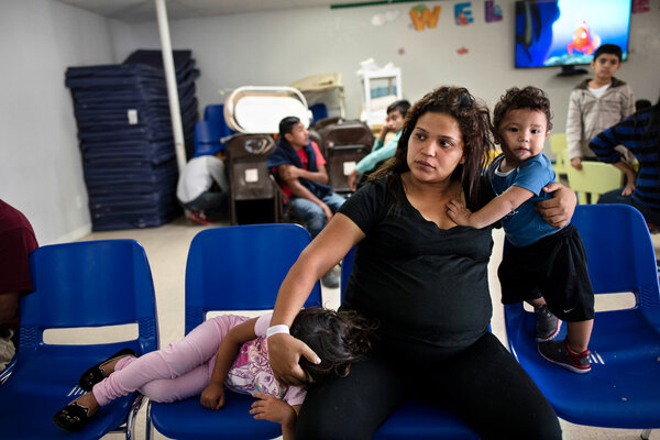 Xiomara Quintanilla, 26, seven months pregnant, sitting with her children, Brianna, 3, and Dylan, 1, several days after crossing the river from Mexico to seek asylum near McAllen, Texas.