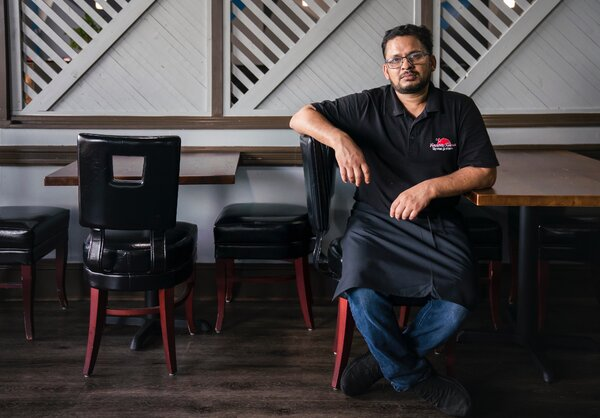 """Alam was loath to reopen his restaurant in late April. """"One of my people gets sick, or I get sick, it's going to be a problem,"""" he said. """"A customer gets sick, it's a <em>big</em> problem."""" He did reopen the dining room in July."""