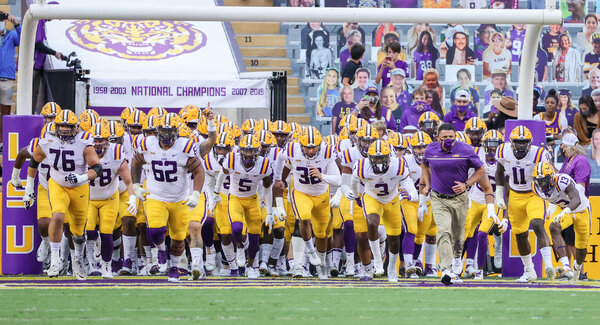 The L.S.U. Tigers football team at the start of a game in October. Their game with Alabama was postponed after positive test results and contact-tracing rules left the team short-handed.