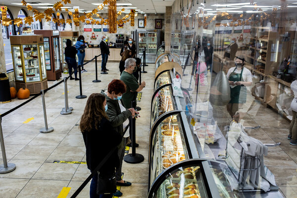 A line of customers order at Calandra's Bakery in Newark on Wednesday, as the city operates under new restrictions because of a sharp increase of coronavirus cases.