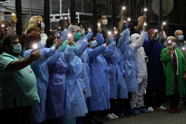 Hospital workers in Sophia participated in an appeal to Bulgarians to comply with restrictions to contain the spread of coronavirus.