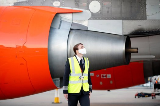 An easyJet pilot carried out safety checks before a flight at London's Gatwick Airport last summer. On Tuesday the carrier said it lost 1.27 billion pounds in the year ending in September.