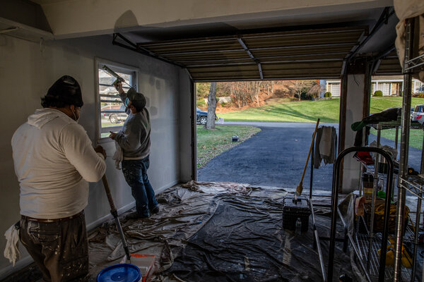 Workers preparing a garage in Poughkeepsie, N.Y., where the family of one epidemiologist plans to celebrate Thanksgiving.