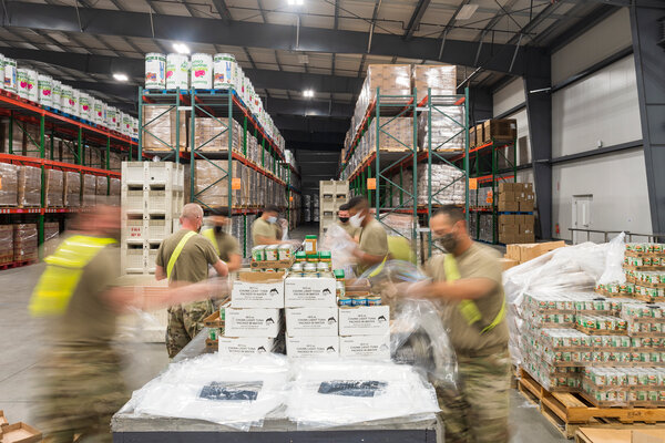 In Salinas, Calif., members of the National Guard provided assistance this month at a food bak, which saw a massive increase in requests for assistance.