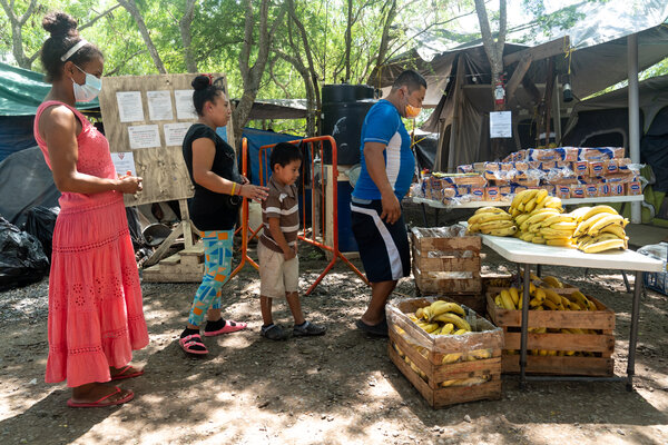 A line for groceries at the camp.