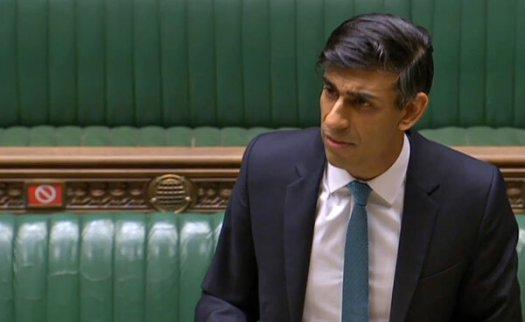 """Rishi Sunak, Britain's chancellor of the Exchequer, addressing Parliament on Wednesday. """"Our economic emergency has only just begun,"""" he said."""
