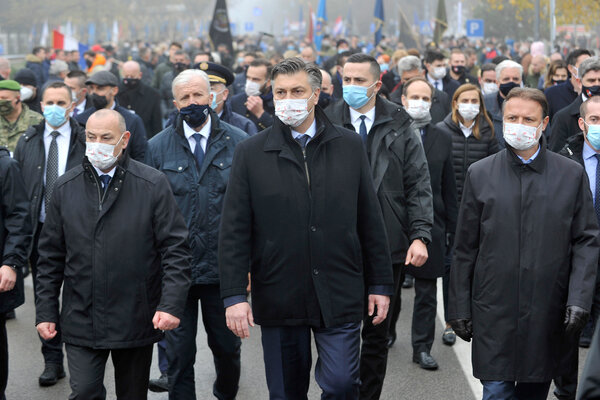 Andrej Plenkovic, the prime minister of Croatia, center, taking part in a commemoration march in Vukovar, Croatia, this month.