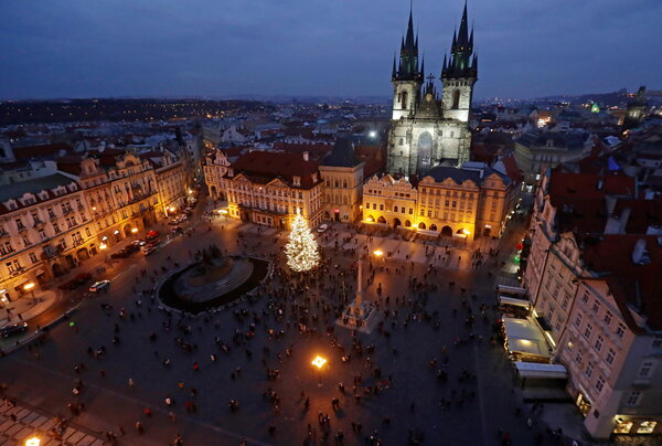 A Christmas tree was illuminated as the traditional Christmas market had been cancelled at the Old Town Square in Prague on Saturday.