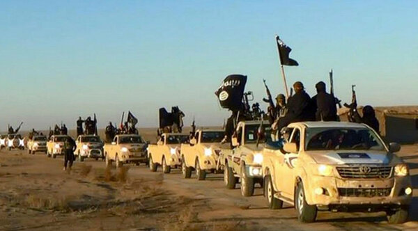 Members of the Islamic State drove through Syria in 2014. Until this week,Christopher Maier's office was responsible for overseeing policy and strategy development regarding the fight against ISIS.