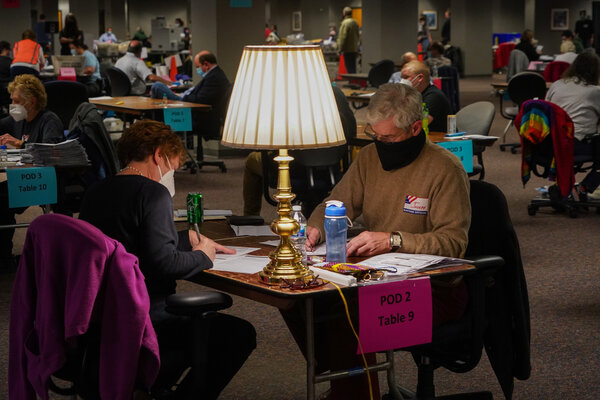 Election workers counted absentee ballots in Milwaukee last month.