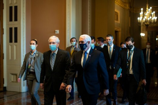Senator Mitch McConnell and Vice President Mike Pence on Wednesday at the Capitol. Mr. McConnell repeatedly reiterated that President Trump's support would be needed for any coronavirus relief deal.