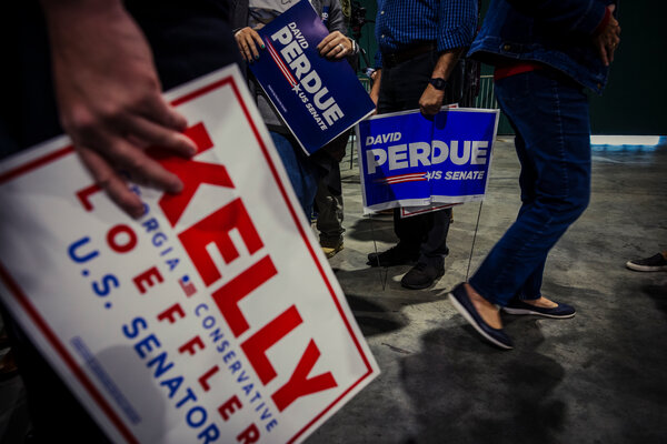Supporters of Kelly Loeffler and David Perdue, the Republican Senate candidates in Georgia, at a rally last month.