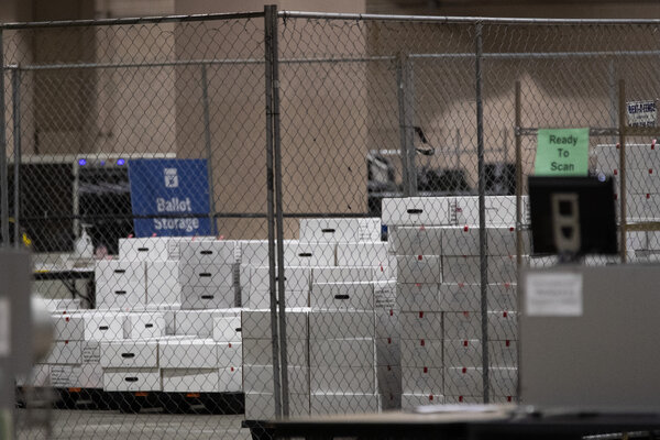 Counted ballots stored behind a secure fence in November at the Pennsylvania Convention Center in Philadelphia.