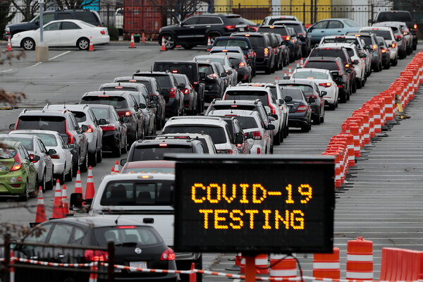 Hundreds of cars in line for coronavirus testing in New Bedford, Mass., this week.
