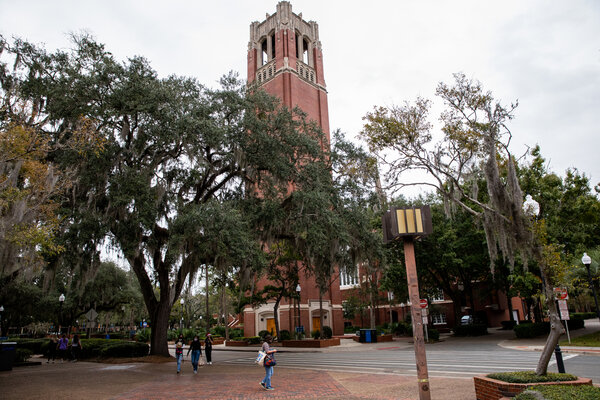 Students on campuson Friday at the University of Florida in Gainesville, Fla.