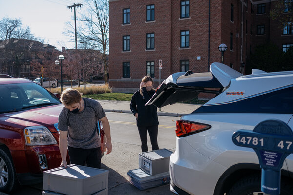 William O'Brien, a freshman at the University of Michigan, packing up his dorm room before the Thanksgiving break. The university has asked many of its students to stay home for the winter semester.