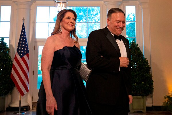 Secretary of State Mike Pompeo and his wife, Susan, arrive at the White House to attend a state dinner.