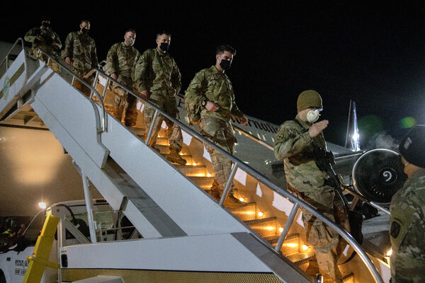 Troops returning on Tuesday from a deployment to Afghanistan at Fort Drum, in New York. The military bill would take steps to slow or block President Trump's planned drawdown of U.S. forces in Afghanistan and Germany.