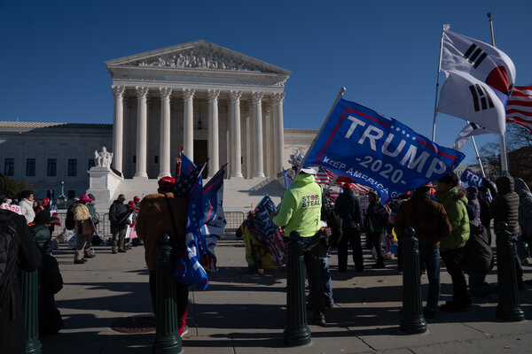 """Demonstrators participated in a """"Stop the Steal"""" outside of the Supreme Court on Tuesday."""