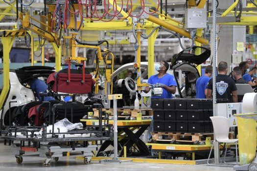 Employees working on the assembly line at the Smart car factory in Hambach, France, in July.