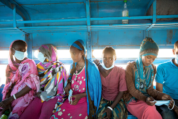 Ethiopian refugees waiting to depart on a bus from Hamdayet, Sudan, to a refugee camp.