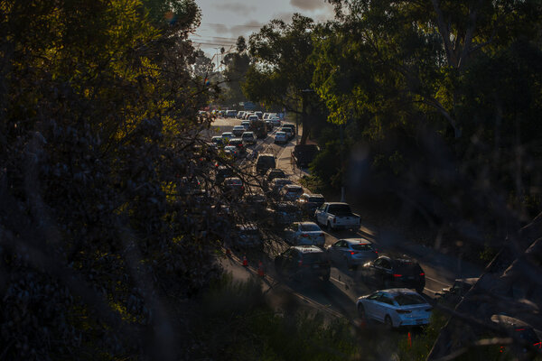 A line of cars waiting for coronavirus testing at the Dodger Stadium testing location in Los Angeles on Thursday.