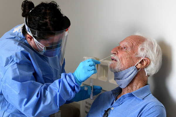 A participant in Moderna's vaccine trial received a nose swab at a hospital in Miami.