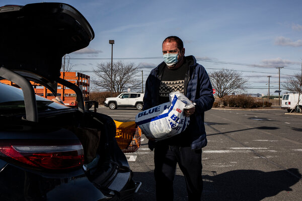 Rubi Koren loading salt into his car at a Home Depot hardware store in Jersey City, N.J., on Tuesday.