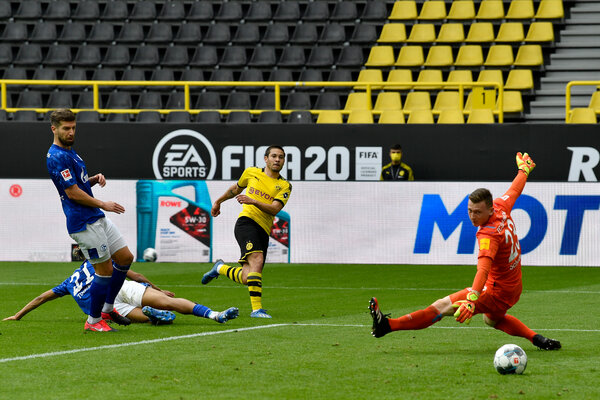 Raphaël Guerreiro scoring the second goal for Borussia Dortmund in their match against Schalke on May 16 at Signal Iduna Park in Dortmund, Germany.