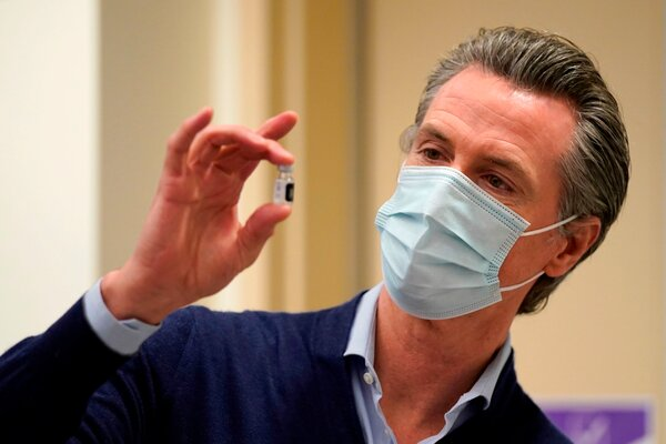 Gov. Gavin Newsom with a vial of the Pfizer-BioNTech coronavirus vaccine in Los Angeles on Monday. Mr. Newsom has said he will wait his turn for the vaccine.