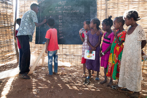 Classes at a makeshift school at the Um Rakuba camp.