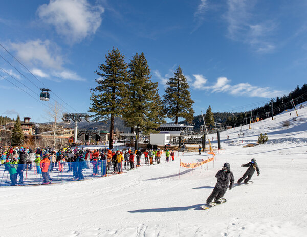 Skiers and snowboarders waited to board the Squaw One Express lift at Squaw Valley Ski Resort recently. The resort has enacted social distancing measures.