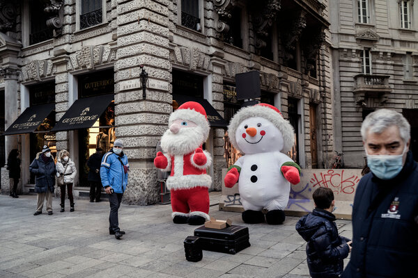 Masked shoppers in Milan's city center this month.