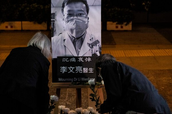A vigil for Dr. Li Wenliang, who died in Wuhan after the police reprimanded him for raising alarms about the coronavirus.