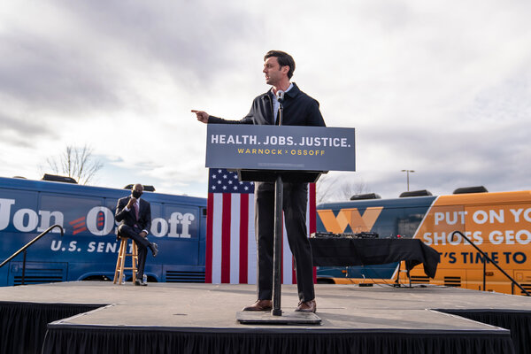 Jon Ossoff, right, and the Rev. Raphael Warnock, Democratic Senate candidates, campaigned together in Stonecrest, Ga., on Monday.