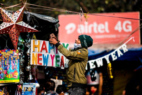 A street vendor in New Delhi on New Year's Eve. Public gatherings will be banned in the capital from 11 p.m. until 6 a.m.