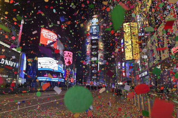 Confetti rains down onto a nearly deserted New Year's Eve celebration in Times Square on Thursday. The celebration has drawn over a million revelers in previous years.