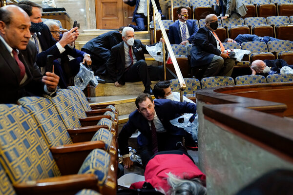 Lawmakers and others sheltered in the gallery of the House chamber before evacuating.