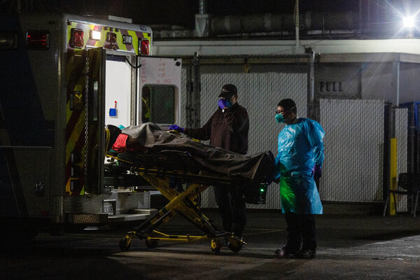 A patient arrived at Community Hospital of Huntington Park in Los Angeles on Sunday night. The region's hospitals have been straining to cope with a flood of patients.