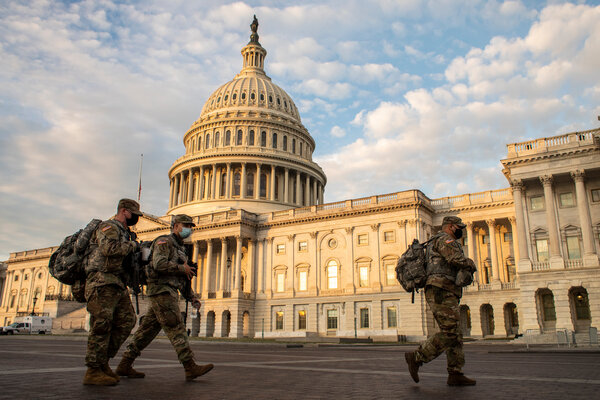 National Guard troops deployed to the U.S. Capitol prepare to head out for a shift change on Thursday.