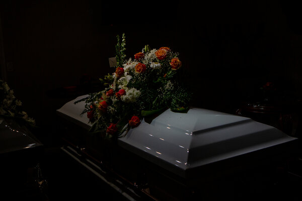 A casket sat in an empty room at a funeral home in Los Angeles on Sunday.