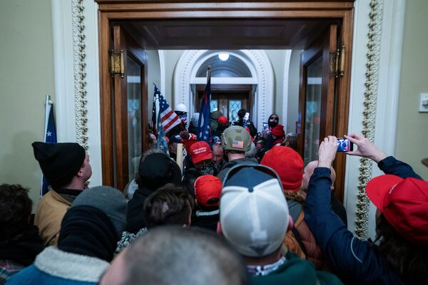 Supporters of President Trump outside the door to the House chamber after breaching Capitol security during a riot last week.