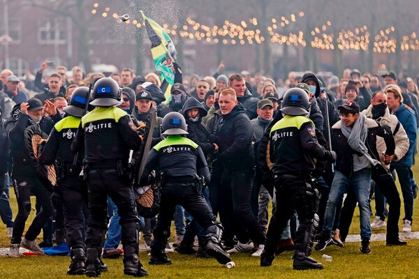 Riot police officers clashed with protesters during a demonstration in the Museumplein, a public square in Amsterdam, on Sunday.