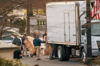 Workers loading boxes into a truck outside the White House last week.