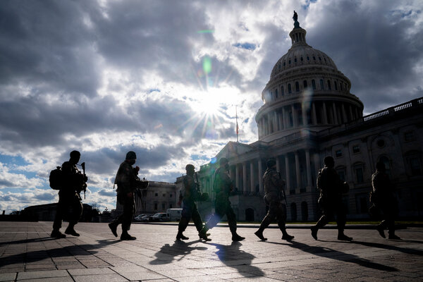 Members of the National Guard walking outside the Capitol in Washington on Sunday.