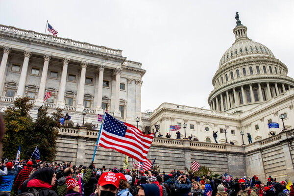 Protestors storm the Senate side of the Capitol on January 6 after a rally where President Trump spoke.